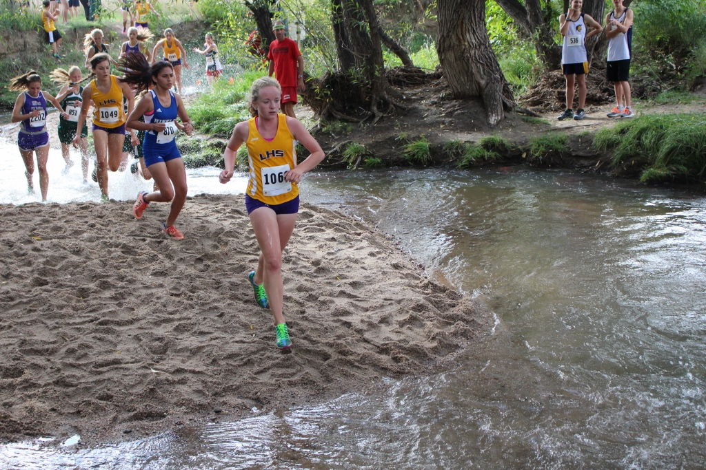 Magda van Leeuwen enters the creek at the LHS Invitational