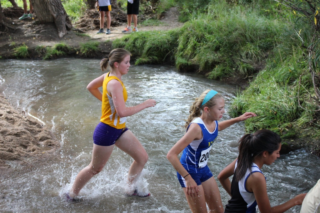 Sophomore Ashby Bell runs through the water