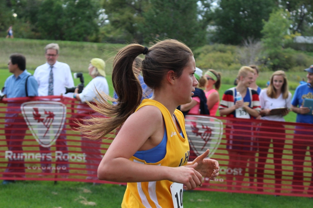 Madeline Espinoza runs to complete the final stretch of the race