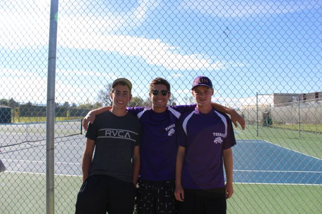 Tennis players Seth Goldstein, Nathan Stauffer and Michael Craig pose after making it to state.