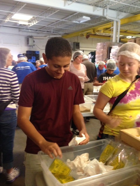 Sophomore Daniel Rivas helps put the finishing touches on items to go to children who may not have enough food.