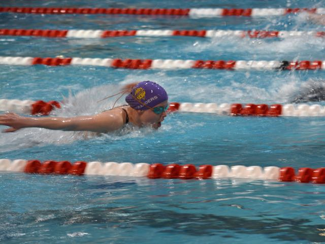 Senior Megan Sanders swims the 100 yard butterfly