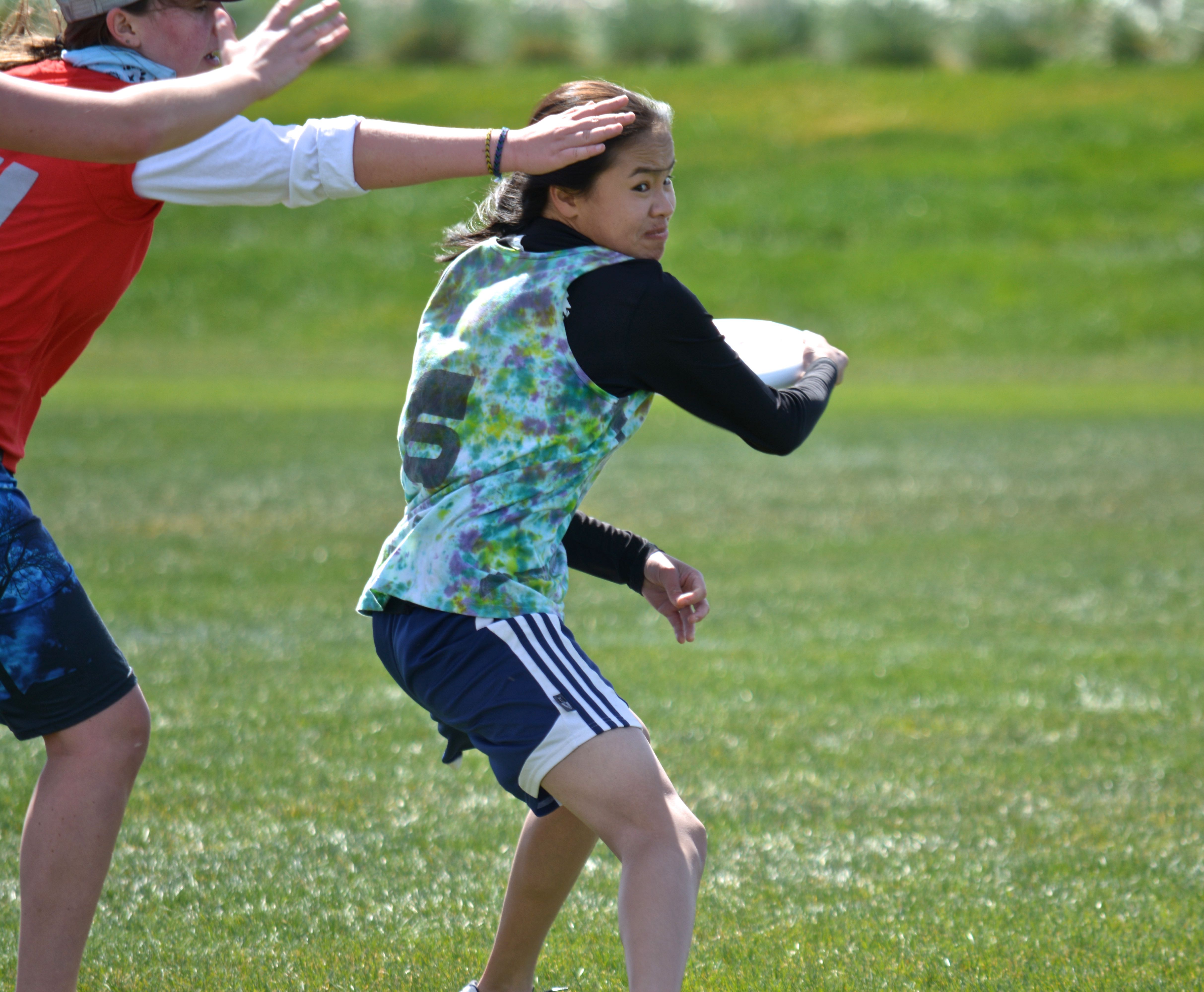 Senior and captain Kiera Lindgren works the disk upwind in the girls' final game