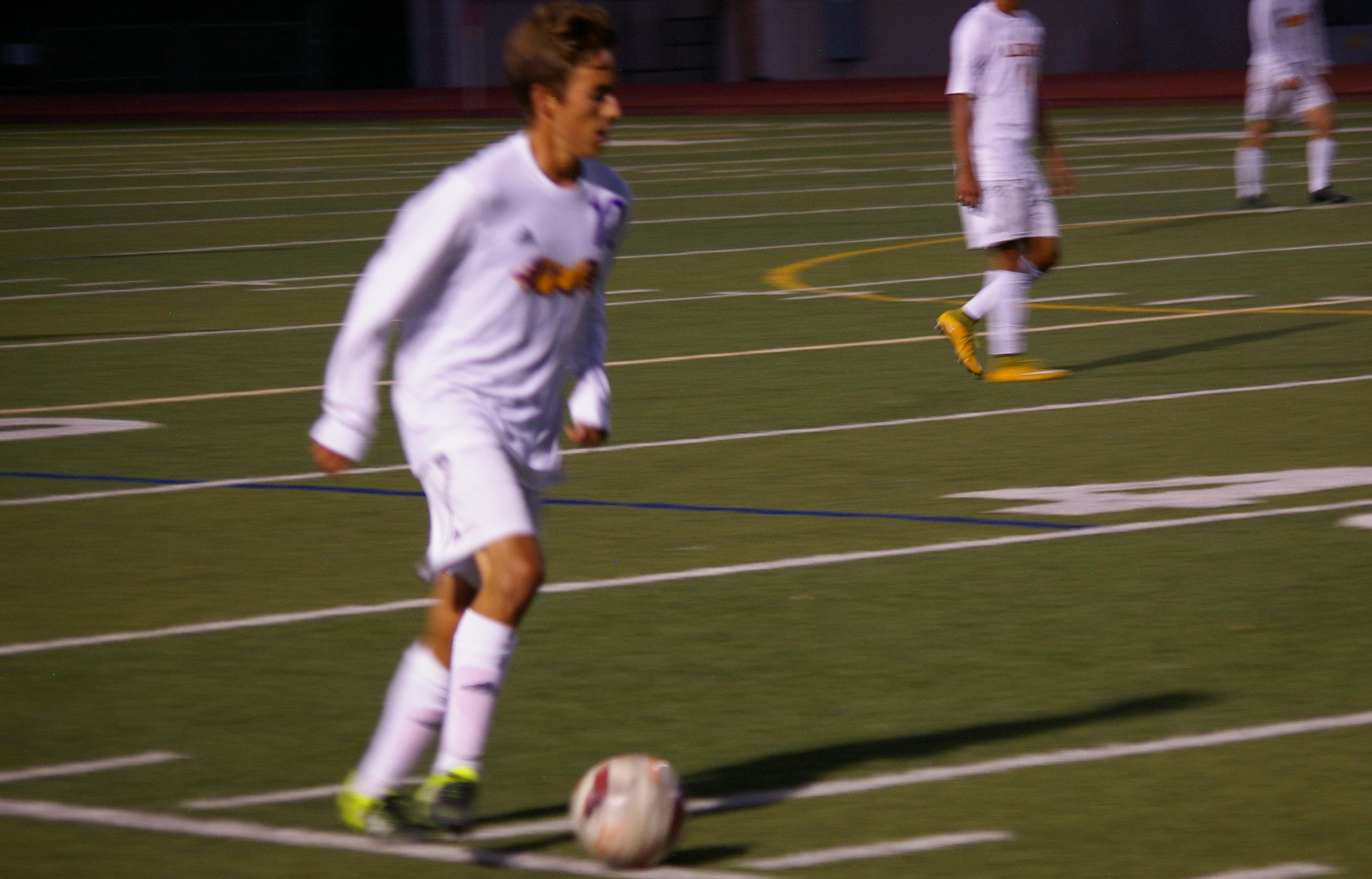 Senior Nathan Stauffer moves the ball down the field
