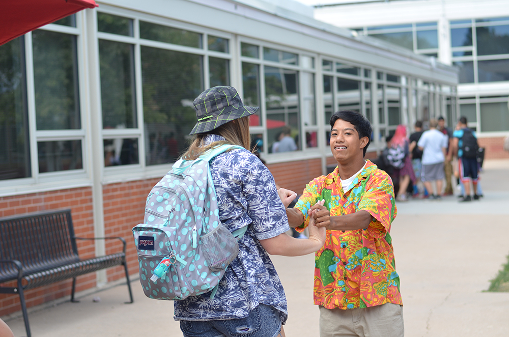 Sophomore Trever DeShon meets with one of his friends during lunch dressed in his Hawaiian shirt.