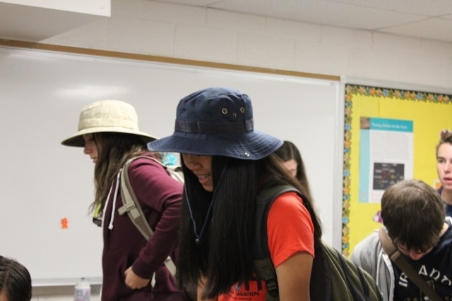 Sophomore Tian McGuire wears her hat in math class for homecoming spirit days.