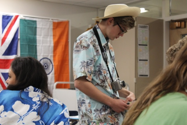 Junior Ben Warzel wears his floppy hat and camera for tourist day.