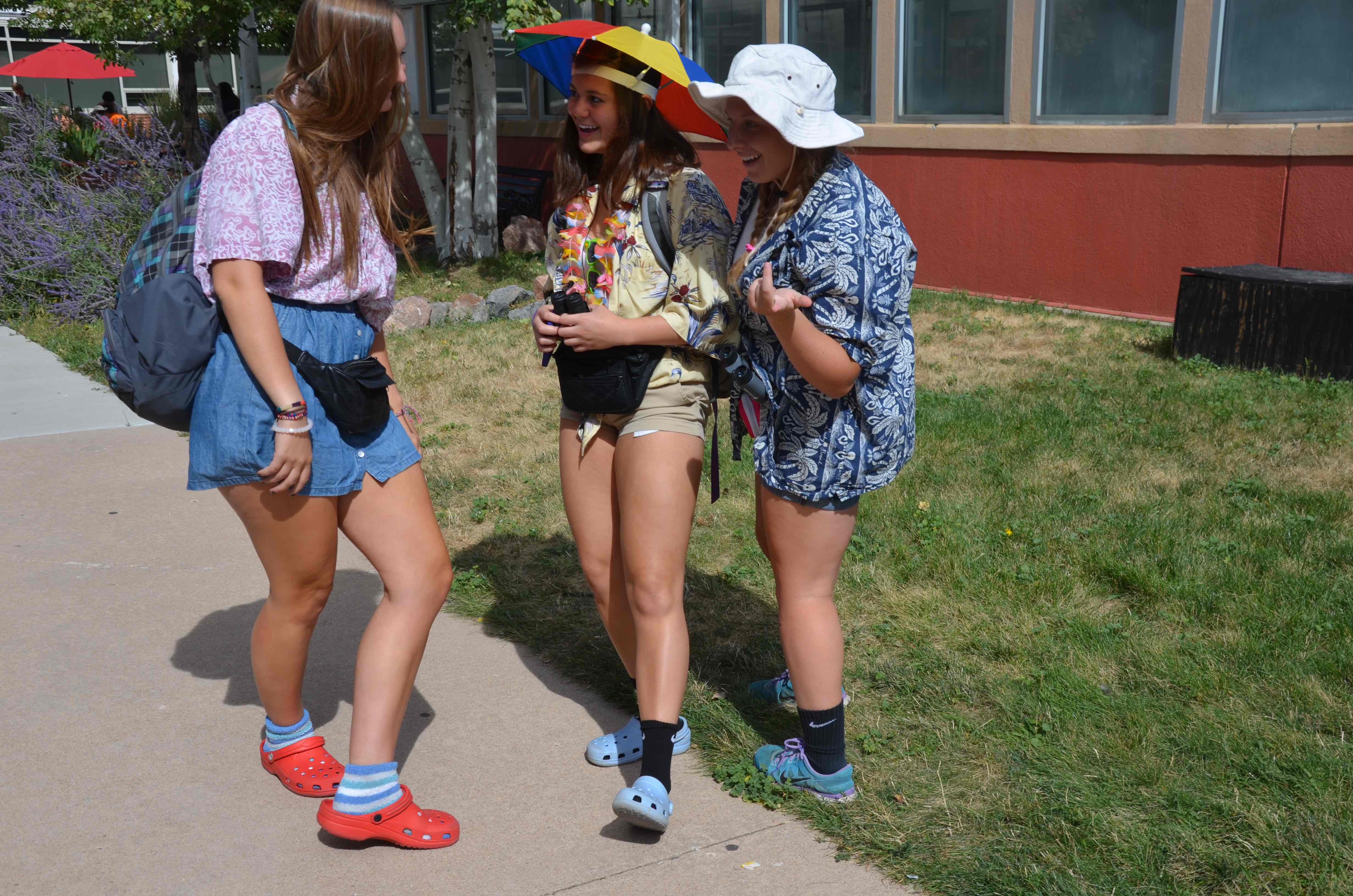 LHS seniors Hailey Egelhoff, Elisabeth Sanson, and junior  Kailee Medved chat in the courtyard during lunch