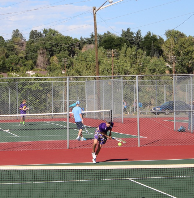 One singles player Jake Anderson serves against Valor in a tough and long match.