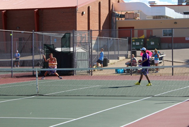 One doubles player Chase Bouck returns serve against valor.