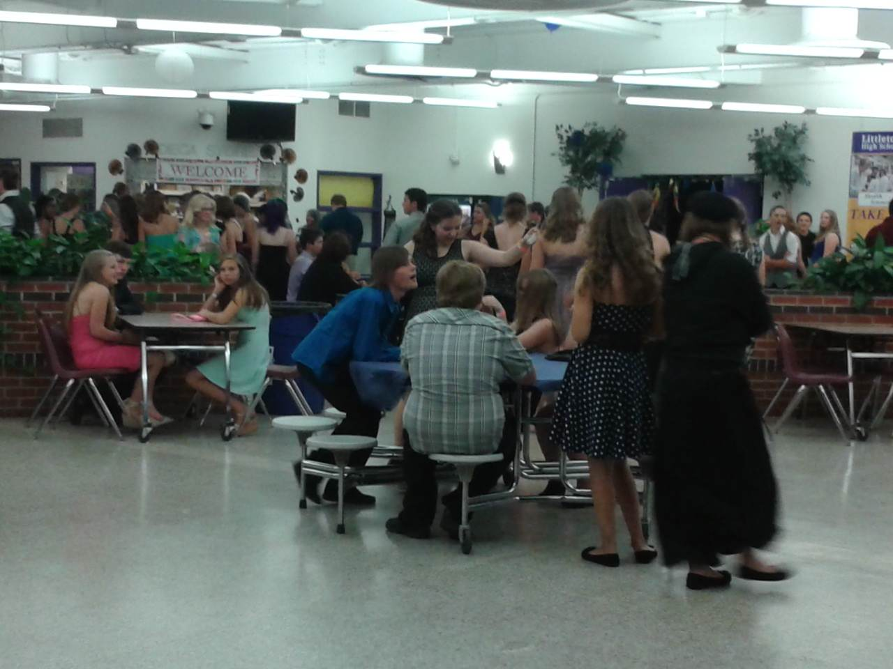 Students take a break during the Homecoming dance and socialize.