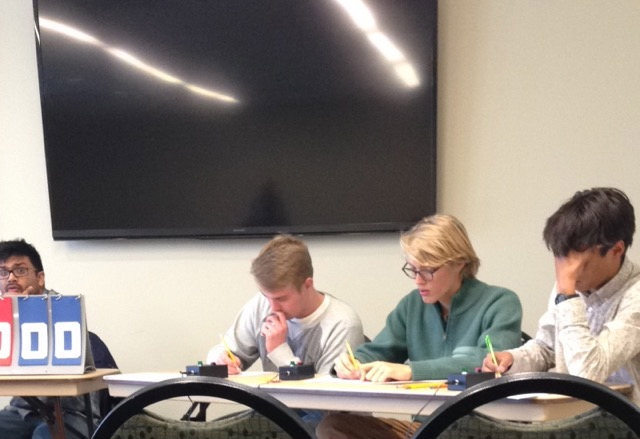 From Left, senior Jake Bloom, senior Cole Becker, and senior Colin Cannon immerse themselves in a challenging problem during one of the team competitions. The team named LHS Group B finished with a record of 4-2.