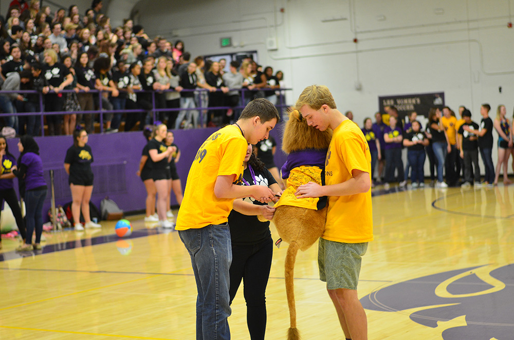 Unified team members sign the spirit lion