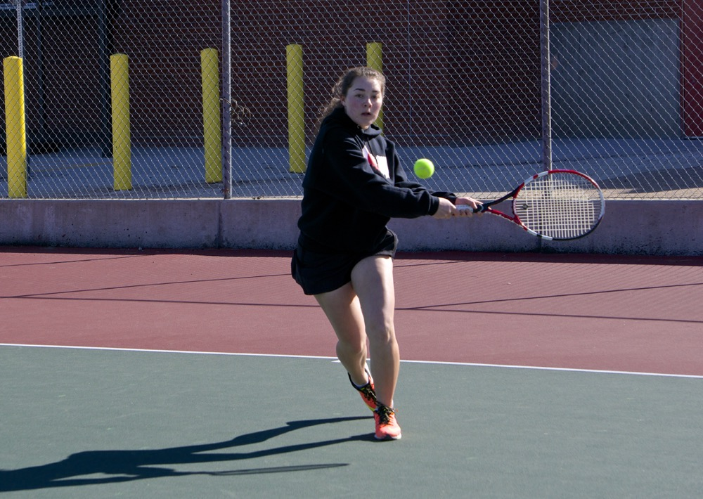 Freshman Gretchen hits a solid backhand.