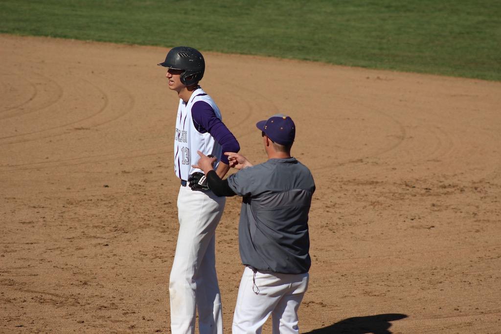 Coach Josh Cox coaches senior Ben Horvat