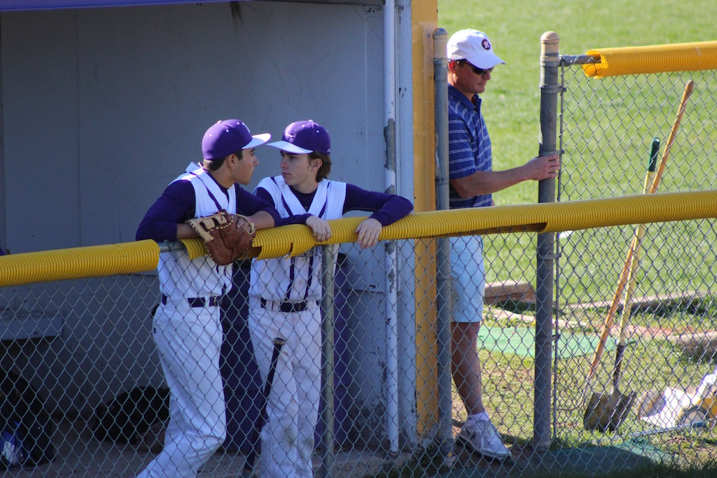 Juniors George Schiebel and Max Fidler discuss the game in the dugout