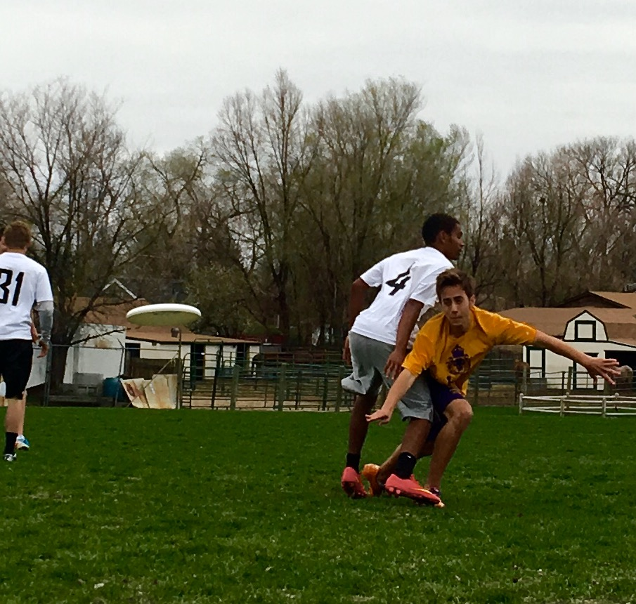 Senior Nathan Stauffer sends the frisbee low.
