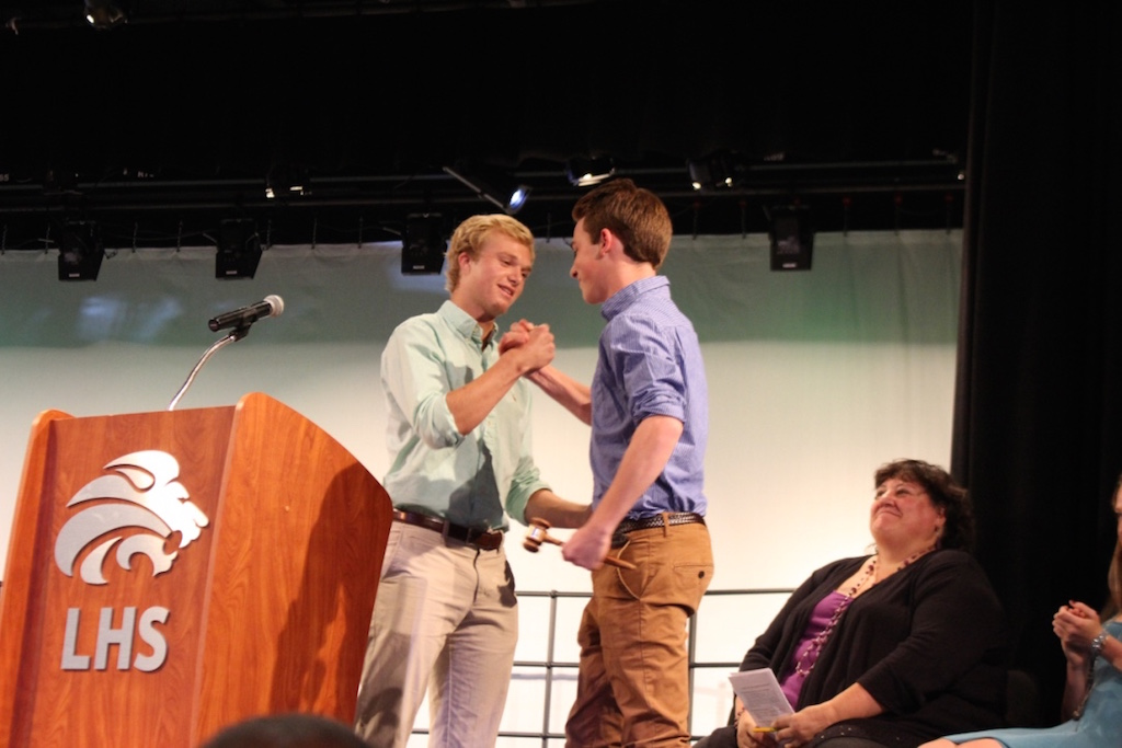 Current student body president Eric Hanson passes the gavel onto 2016-2017 student body president Andy Bredar