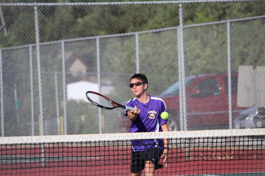 Two doubles player Zach Fox attacks the net to win the point