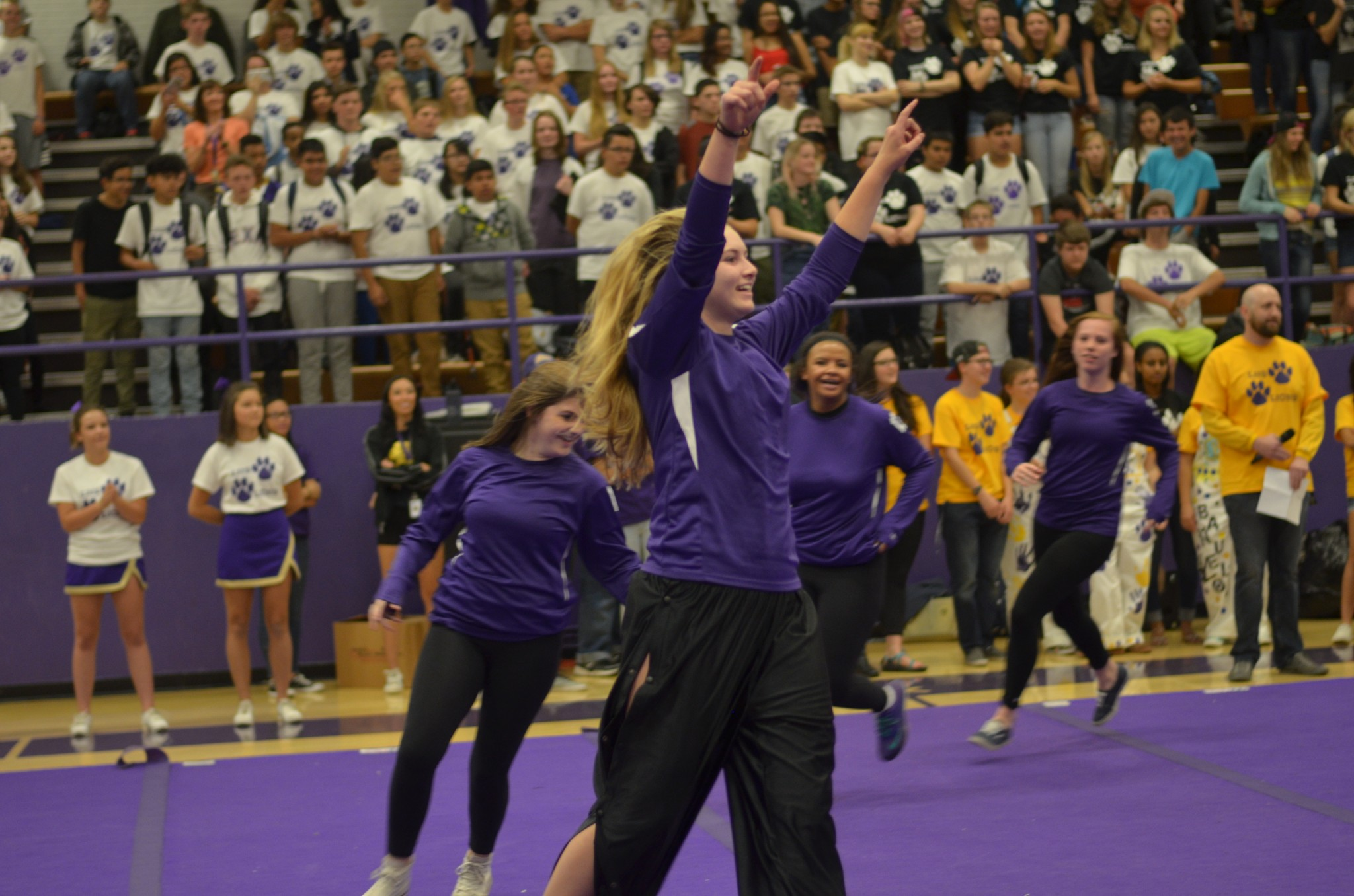 Senior Mallory Burbage leads the volleyball team in their cheer.