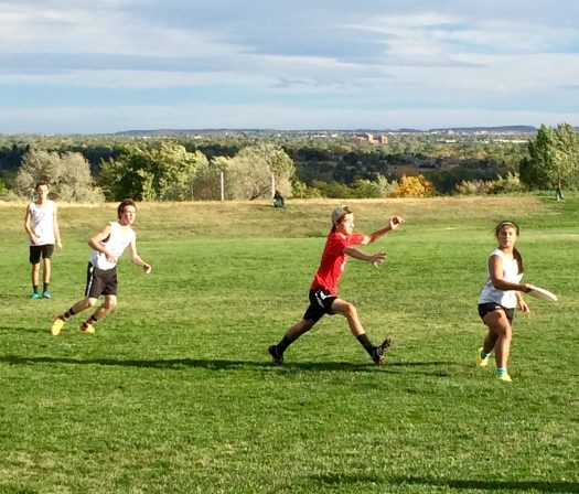 Senior Sanjali DeSilva prepares to pass the frisbee.