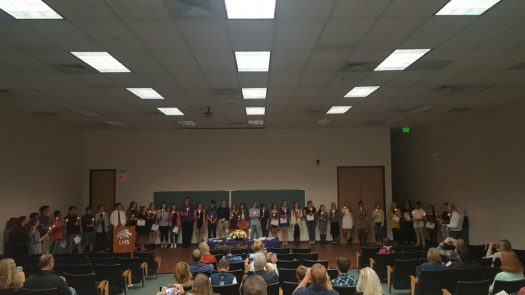New members hold candles at induction