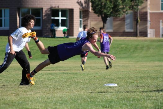 Senior Andy Bredar jumps to catch the frisbee.
