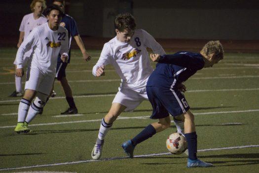 Midfielder Evan Montgomery steals the ball from an Evergreen player