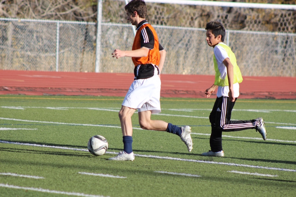 Senior Nick Castle dribbles the ball toward the goal
