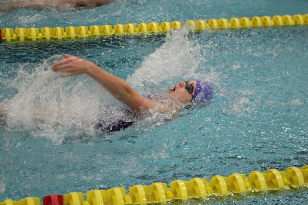 Freshman Natalie Parkhurst swims backstroke