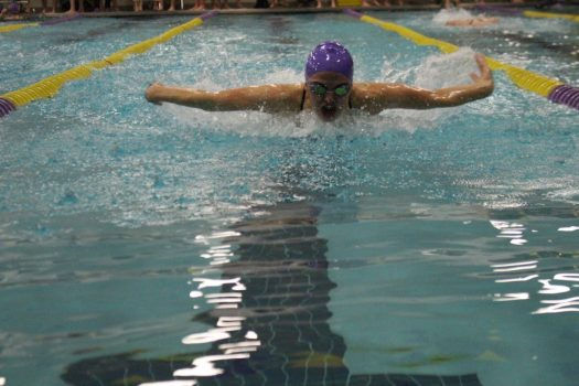 Junior Reganne Fornstrom swims fly