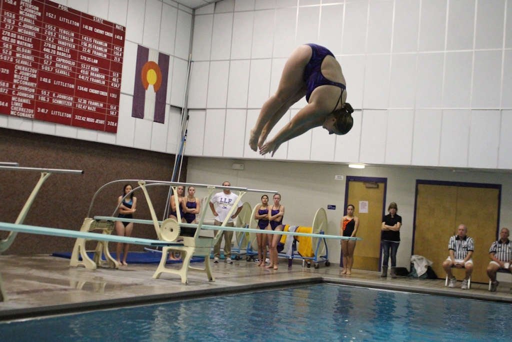 Senior Madi Deter performs her front dive pike