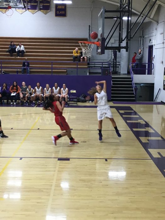 Junior Katie Puchino finesses a layup