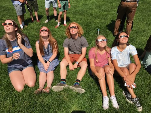 Happy to be out of class, seniors take advantage of the once in a lifetime eclipse.