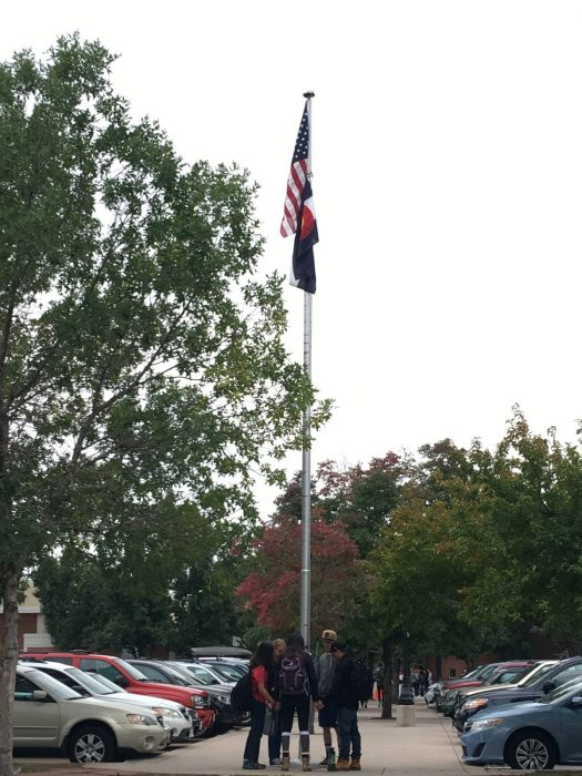 Students pray around the flag pole.