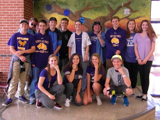Students show off their purple.
