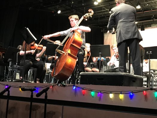 Senior Logan Nelson performing a bass solo