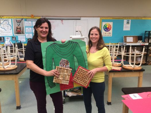 Club sponsors Mrs. Cone and Ms. Pond display event poster and crafts to be sold for the fundraiser.
