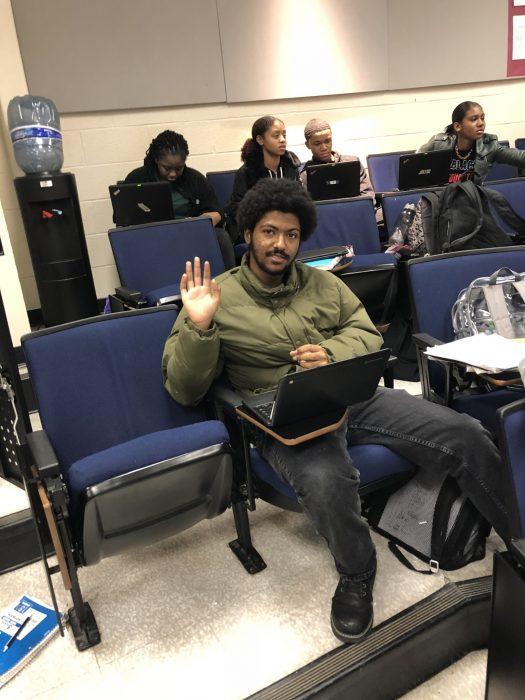 Manuel sitting in class