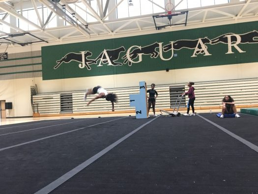 Mikayla Powell throwing her full twisting tumbling pass