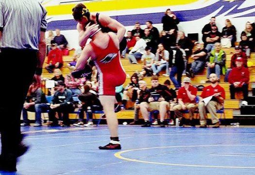 Hawks wrestler taking down opponent
