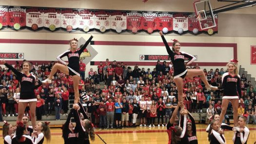 Cheer team demonstrating one of their many great cheers