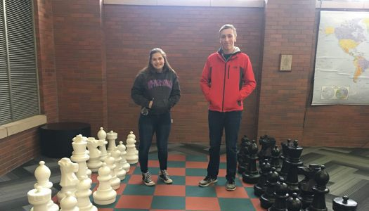 Brittney Angeli and Marcus Welander enjoy giant chess game.