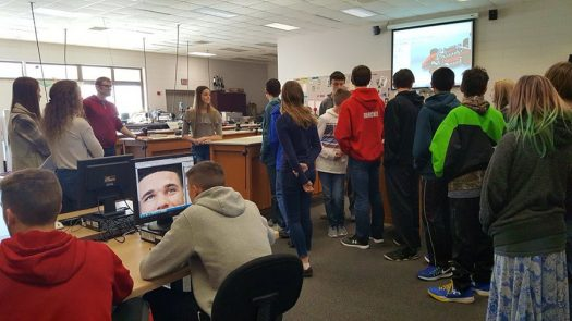 Eighth graders stop in the Graphic Arts classroom