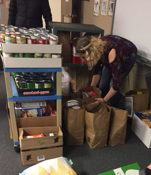 Students organizing the donated food.