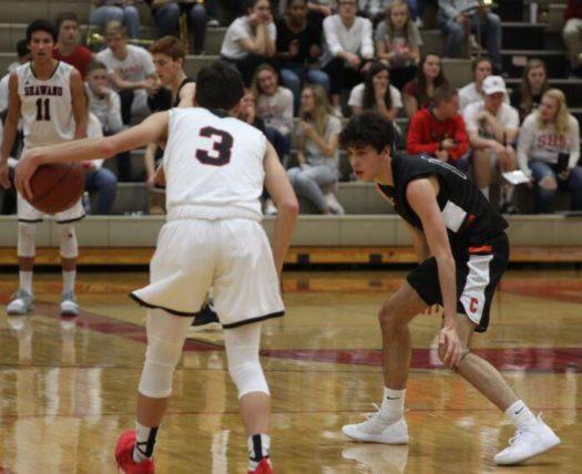 Nick Sherman playing basketball.