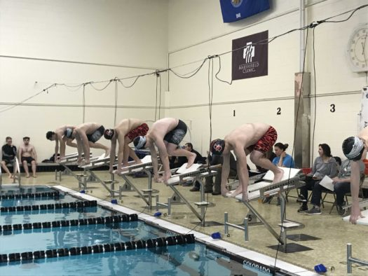 Boys swim at a meet