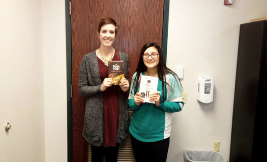Mrs. Lamers and Autumn Vanderlinden of SCHS's Book Club with this month's book selections.