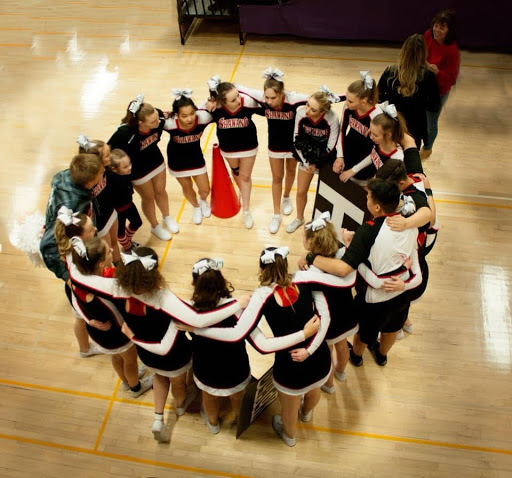 Cheer team huddles up before performance