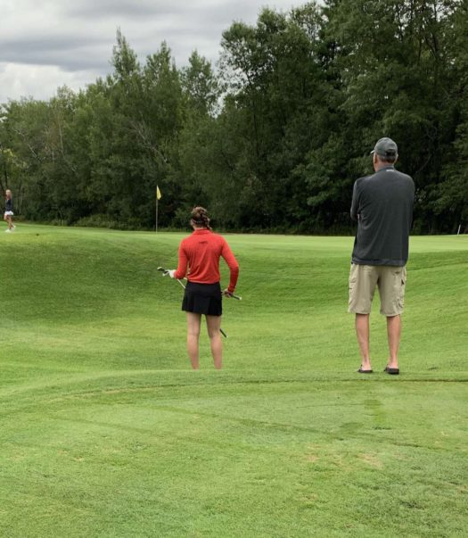 Johnson and Coach Kugler on the course.